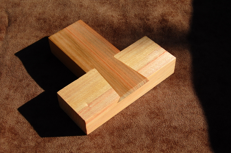 Triple Dovetail Puzzle Finely Strung